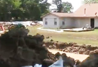 Man Builds Moat Fortress To Save Home From Flood