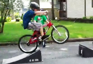 Kid Fails Bike Ramp Jump