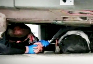 Officer Crawls Under Bus to Comfort Woman Pinned Under Wheel view on ebaumsworld.com tube online.