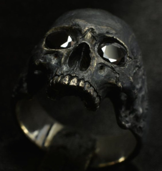 43 - Jewel encrusted melting skull with black rubies for eyes- last image of the list for Hump Day.