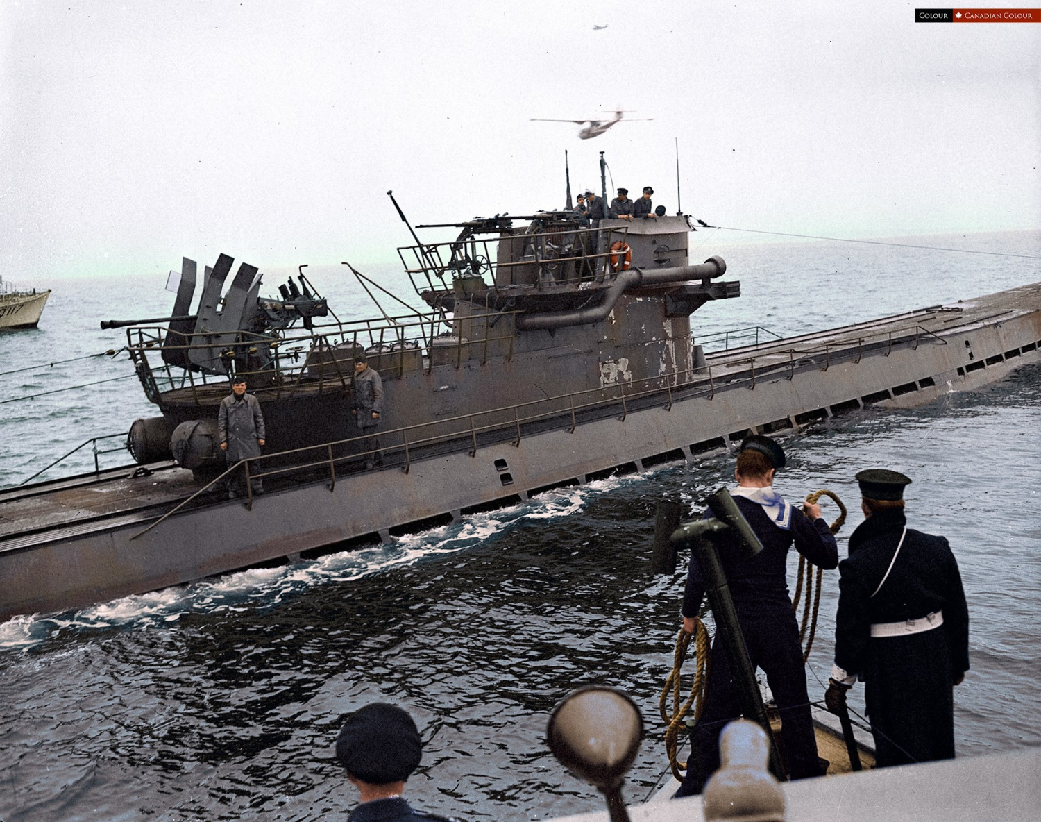 20 - Colorized photo of a German U-889 surrendering to a Canadian built Fairmile Q-117 off Shelburne Nova Scotia May, 1945