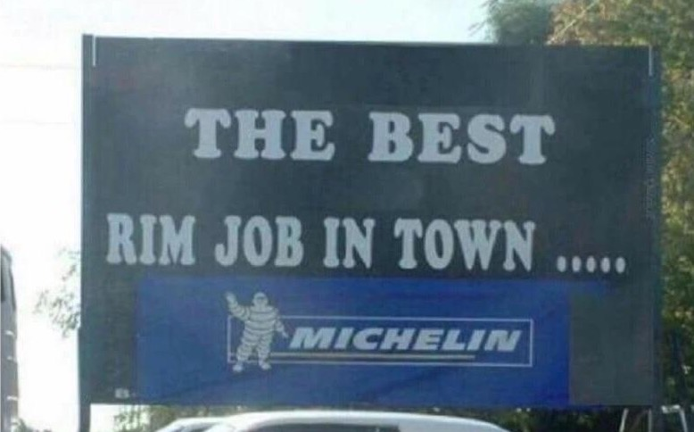 32 - Pun sign for tire shop selling Michelin tires 'rim job'