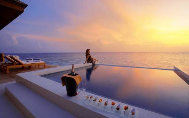 40 - The beautiful balcony overlooking the sea, with a bucket of champagne next to the infinity pool