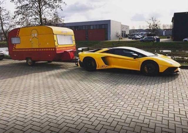 2 - Beautiful yellow Lamborghini pulling a trashy looking trailer.