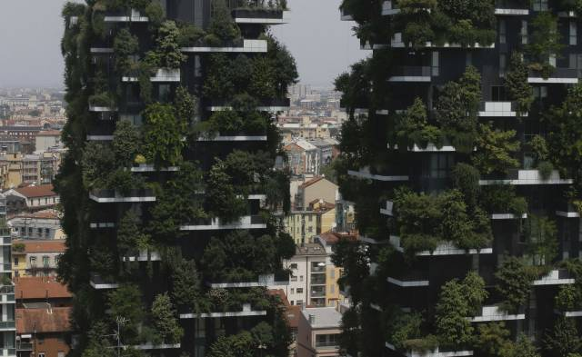 29 - Massive sky scrapers covered in green trees growing on the tenants balconies.