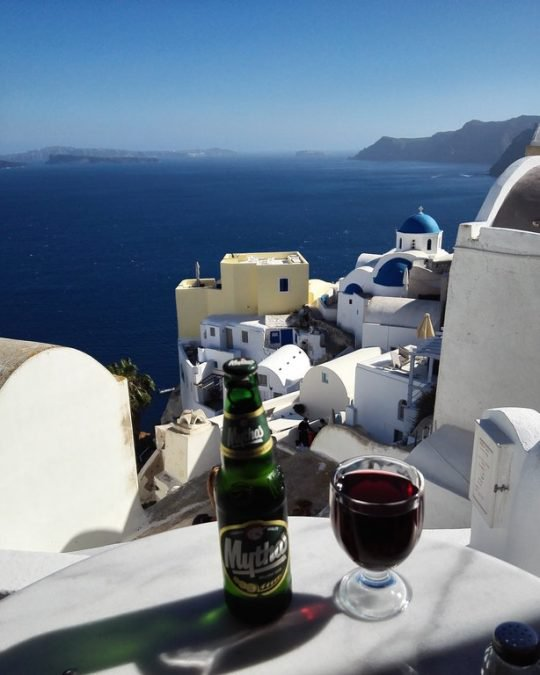 25 - Who wouldn't want to have a drink in Santorini, Greece?