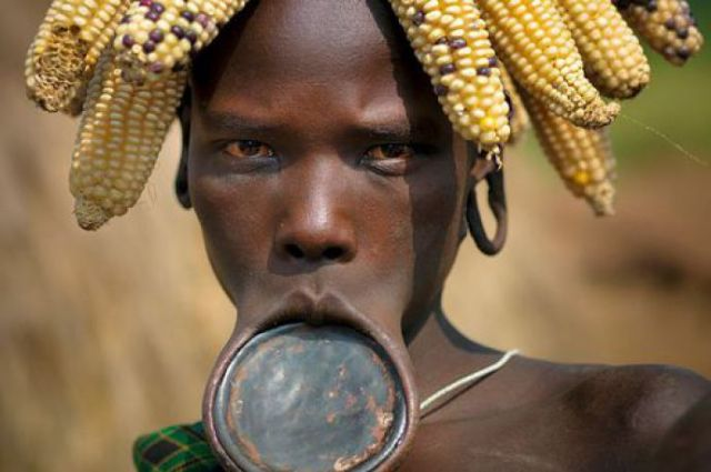 12 - Mursi woman with lip plate in Ethiopia.