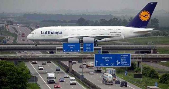 4 - Airbus A380 crossing the Autobahn at Leipzig airport in Germany.