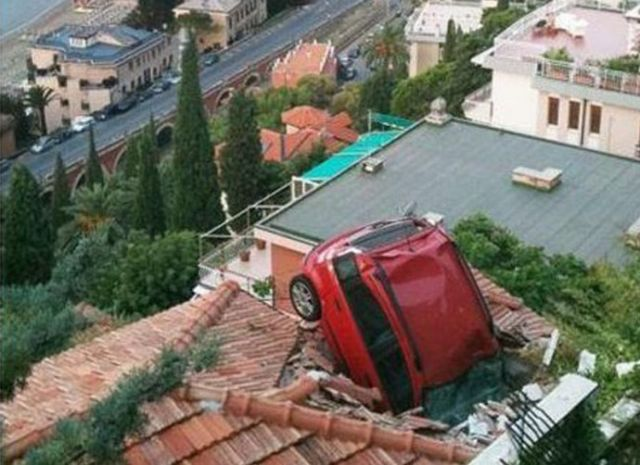 19 - A Fiat Panda ended up rolling off the street into a roof when the owner forgot to put on the handbrakes.