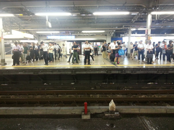 27 - Tokyo commuters waiting for the train.
