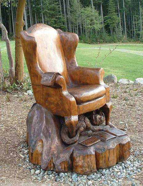 24 - Wooden chair carved from a tree stump.
