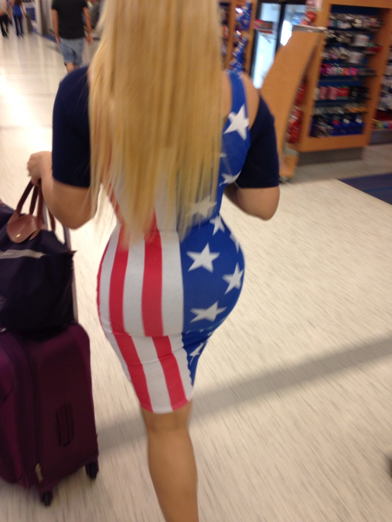 1 - Shapely woman wearing a dress that looks like the American flag.
