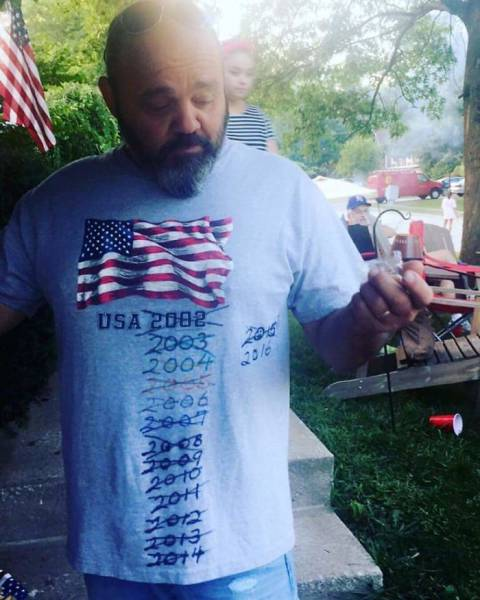 6 - Man with a shirt that said USA 2002 that has been crossed out and updated every year till 2016
