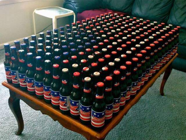 14 - Beer bottles arranged so that they resemble the pattern outline of the American flag.
