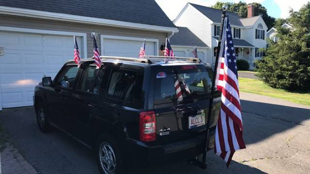 30 - Jeep decked out with like 7 flags.