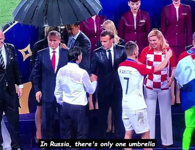 3 - meme joking that there is only 1 umbrella in Russia and showing picture of Putin, Marcon and his wife in the rain congratulating the players