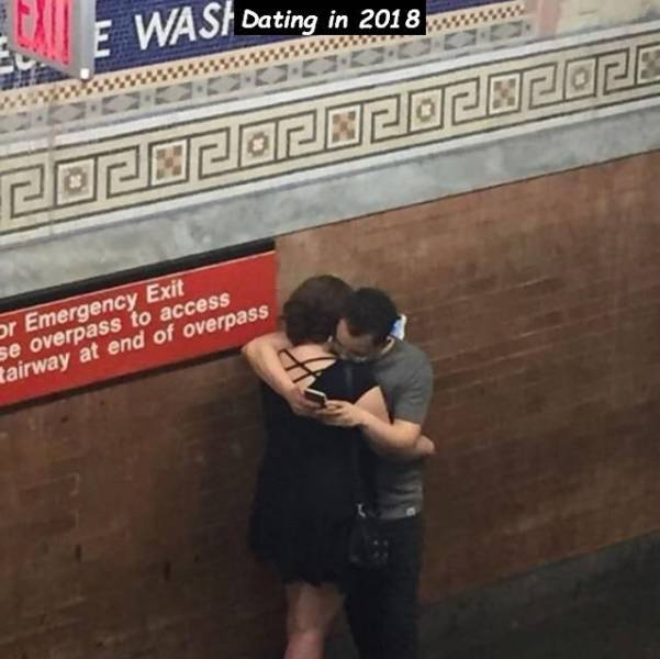 9 - people hugging on the stairs because they are on their phones and can't untangle