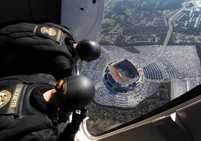 18 - great picture of skydivers over a stadium