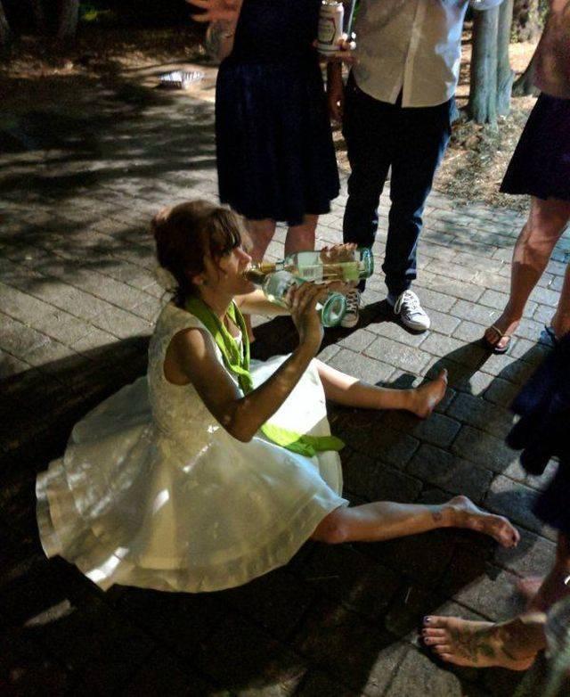 23 - woman in wedding dress drinking form two bottles