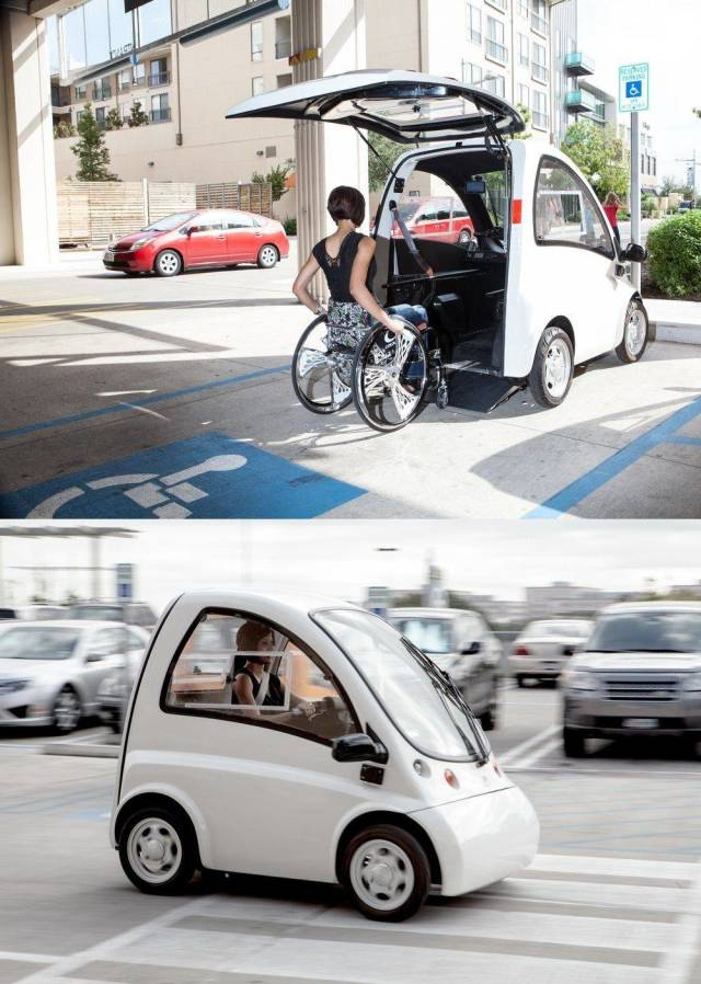 32 - women in a wheelchair loaded into a mini car so she can drive on the road with ease
