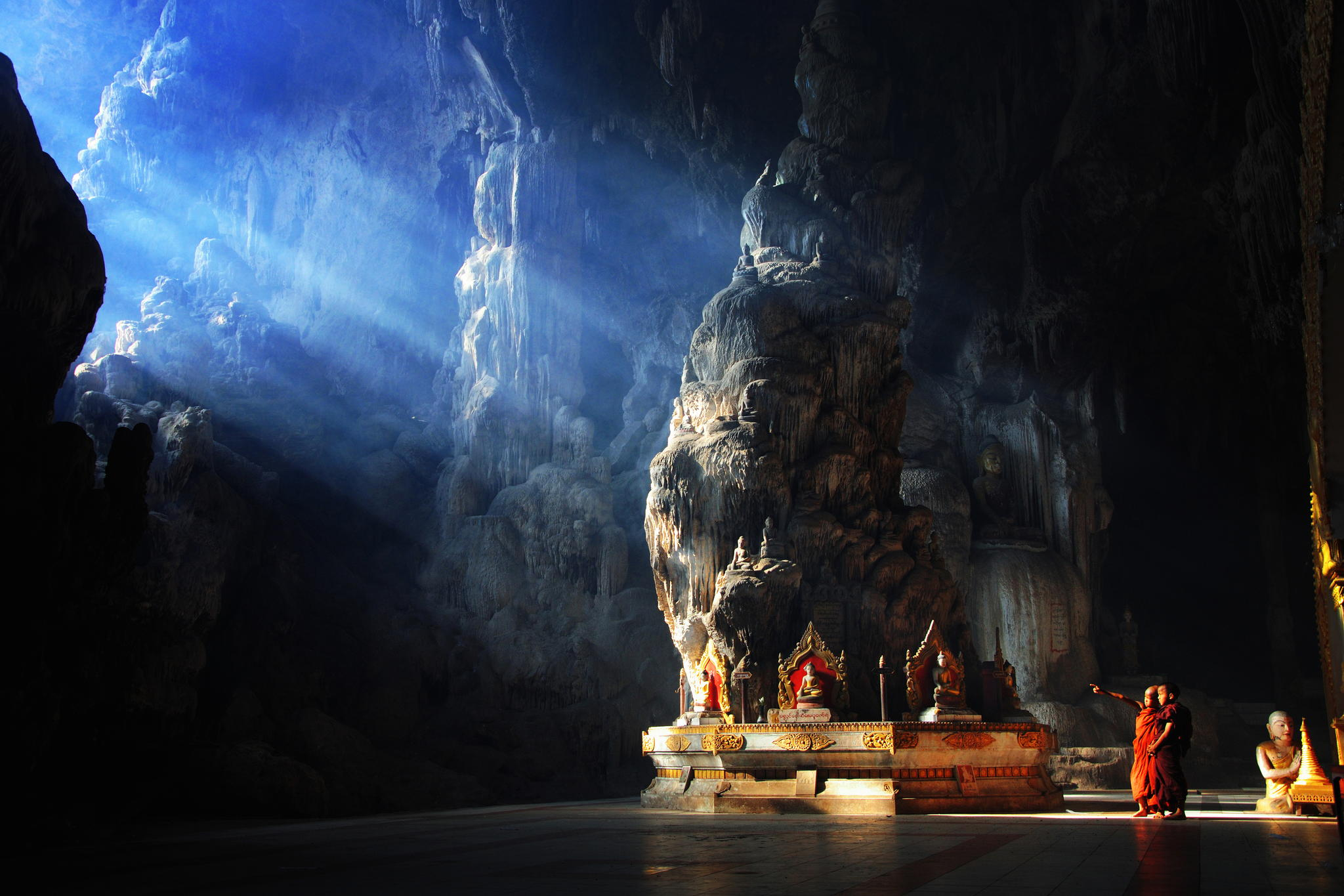 25 - A Buddhist temple inside a cave, Myanmar.