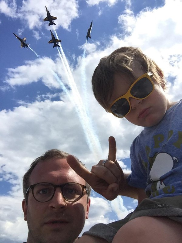 4 - Awesome father and son pic of hanging loose sign with fighter jets breaking out of formation.