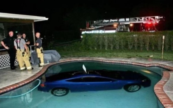 7 - Funny picture of a car that is at the bottom of a pool.