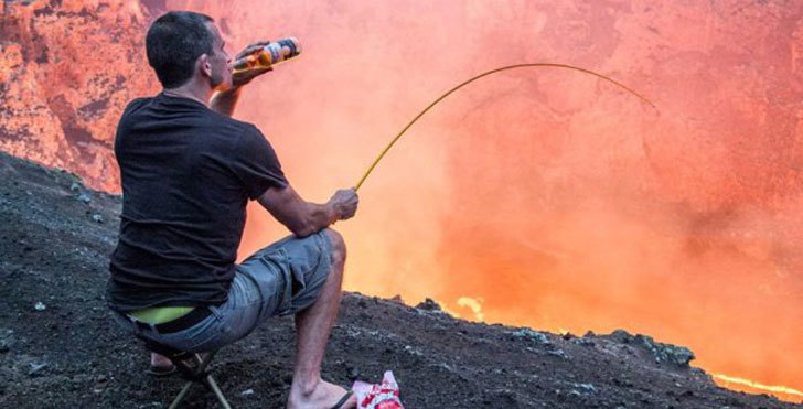 3 - Man drinking a beer and fishing into an active volcano