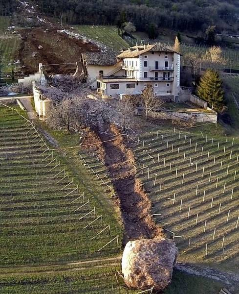 """11 - """"Close call: Boulder nearly takes out Italian farm house."""""""