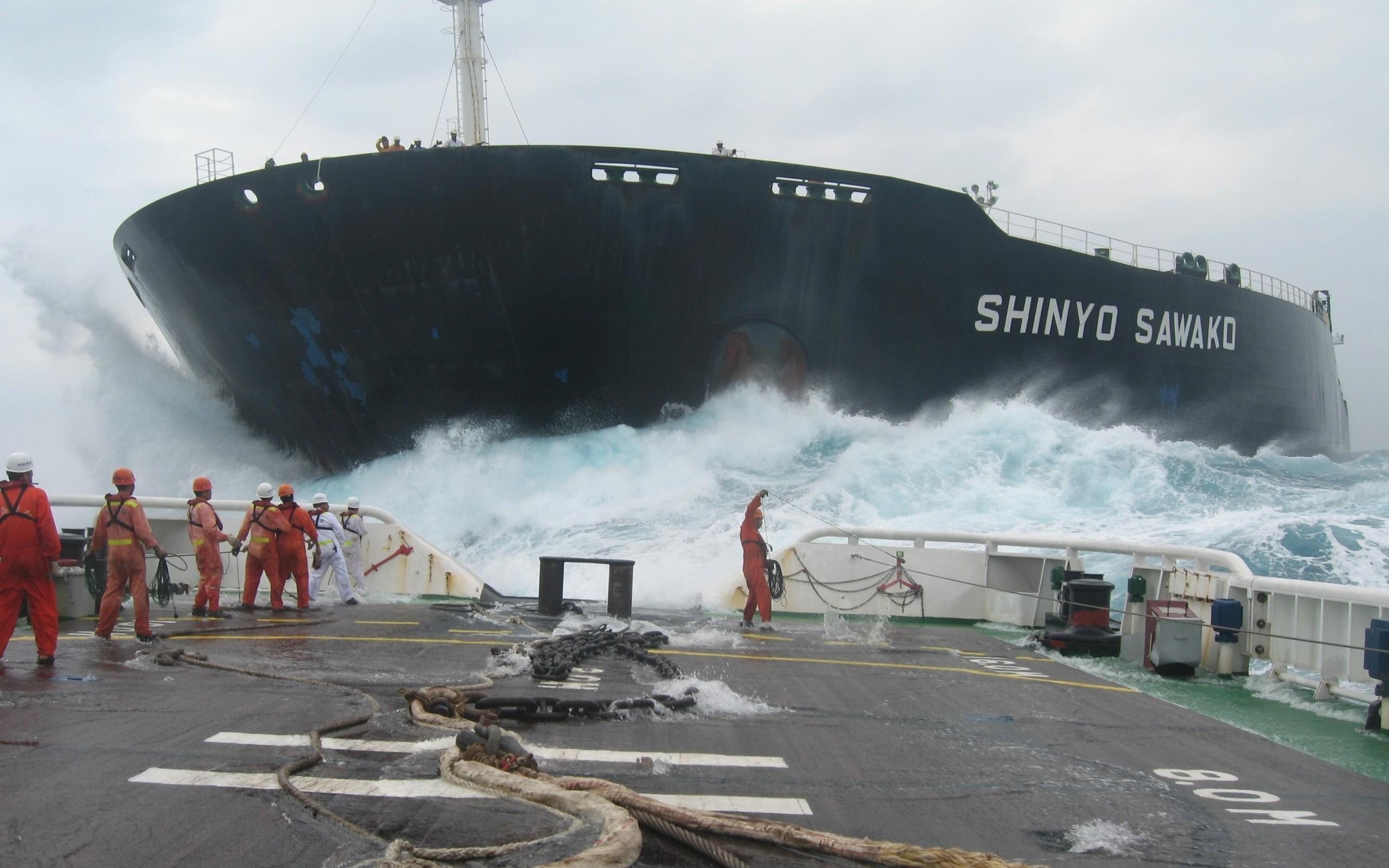 1 - A tugboat approaches Hong Kong freighter, the Shinyo Sawako