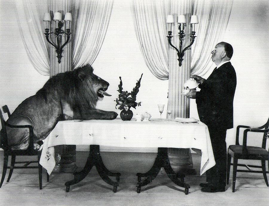 Alfred Hitchcock serving Lion.