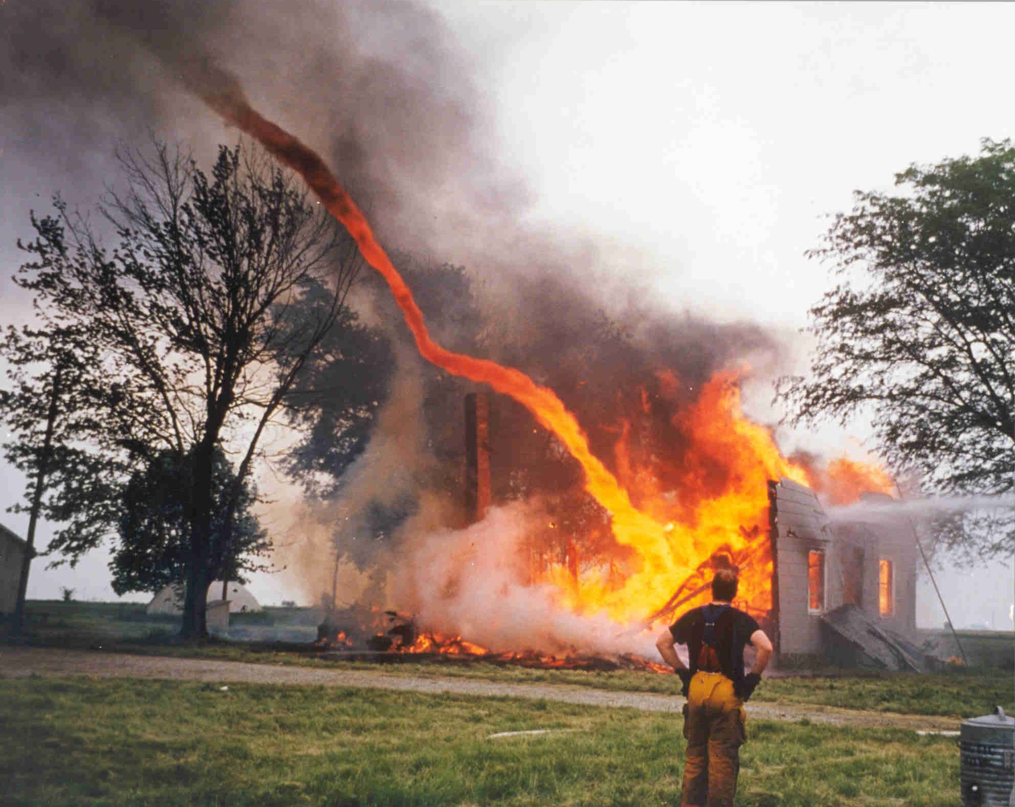 6 - Fire from a burning bulding being sucked into a tornado