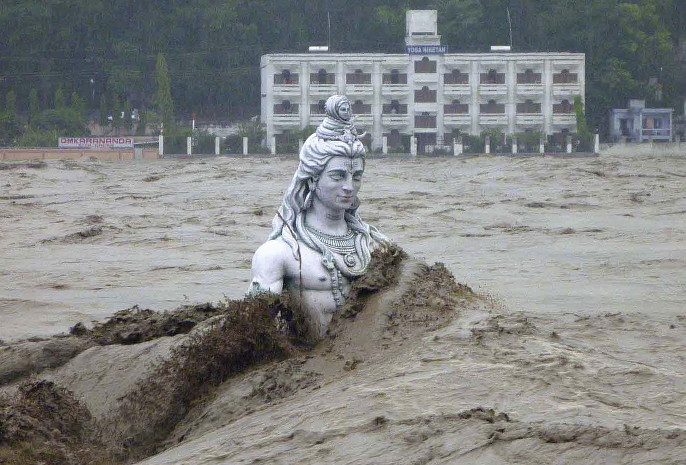 10 - A submerged statue of the Hindu Lord Shiva amid the flood waters of the river Ganges, June 17, 2013