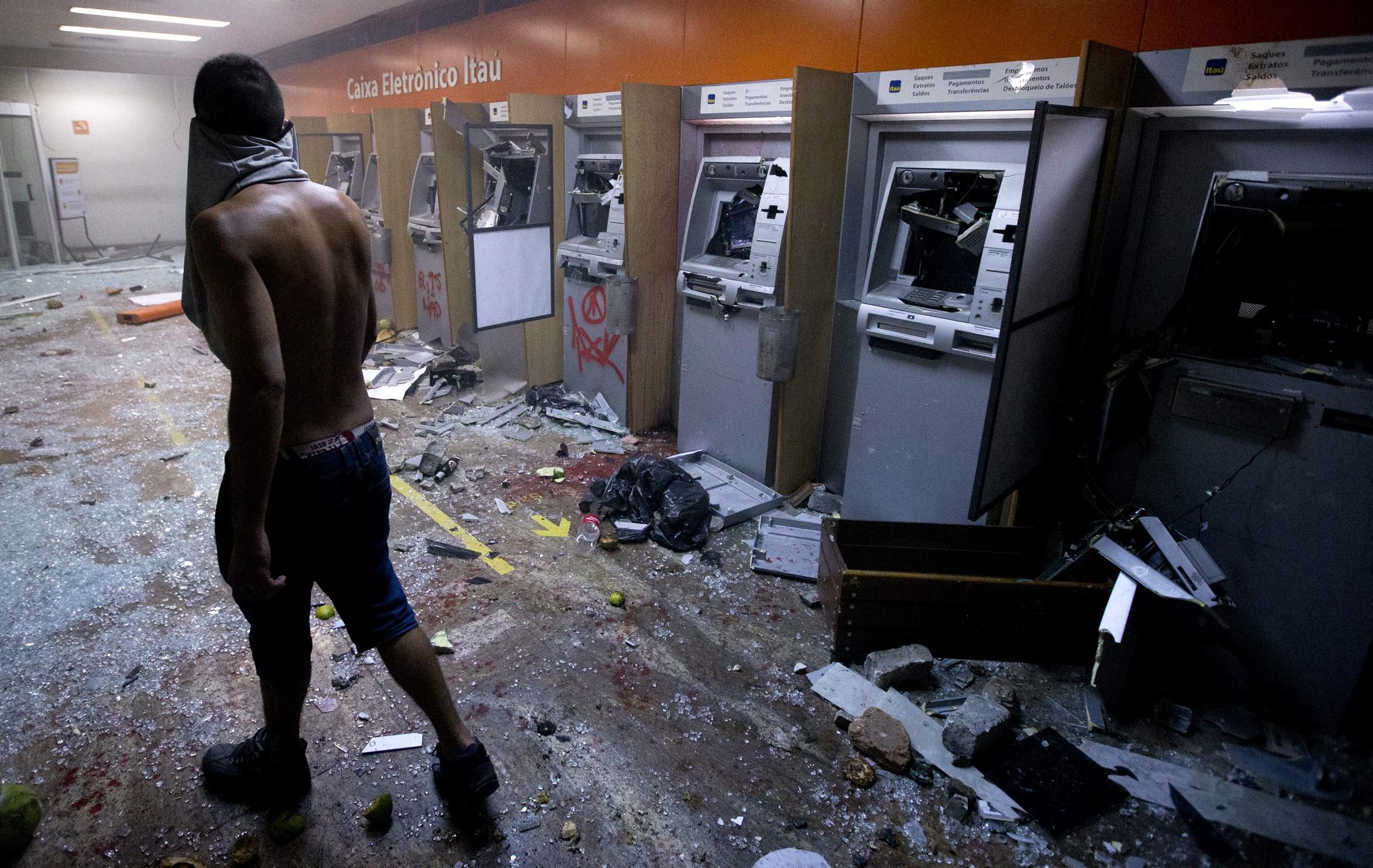 24 - Cash machines in a bank in Rio de Janeiro, Brazil. June 17th 2013