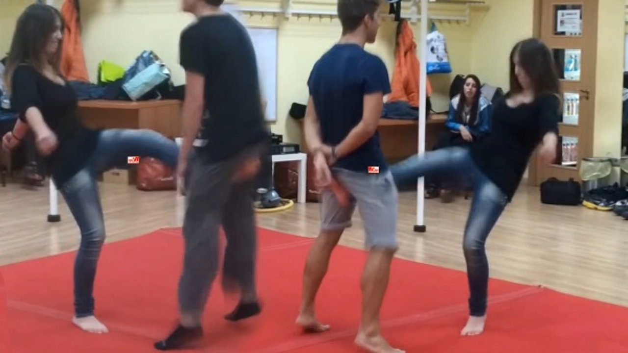 Girl kicking guy in the nuts