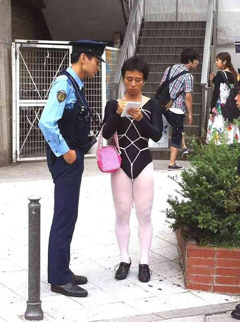 8 - Strangely dressed woman writing a ticket to a cop.