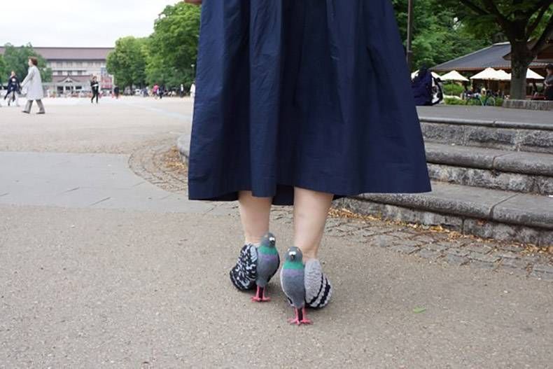 9 - Woman wearing heels that look like pigeons.