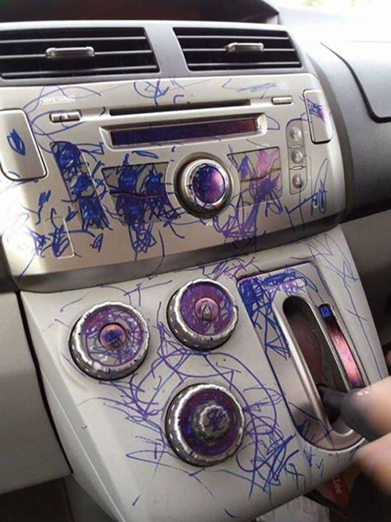 17 - Disaster photo of letting a kid doodle on your car's interior.