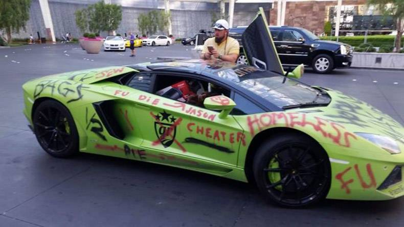 21 - Sweet Lamborghini spray painted with profanities from a tainted lover.
