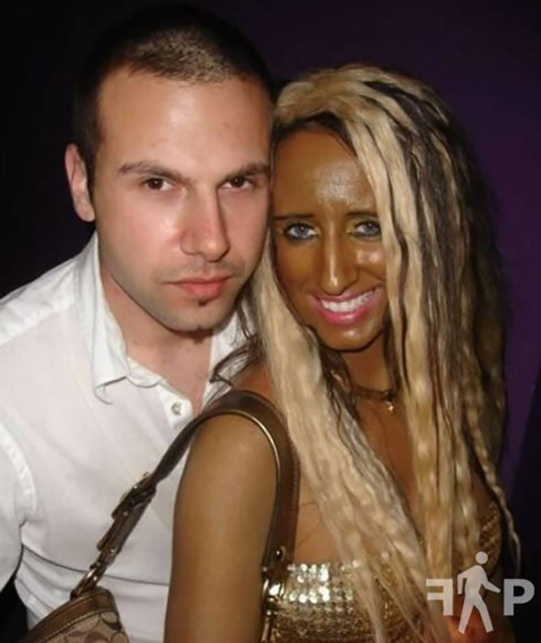 37 - Girl who is way too tanned posing with normal white dude.