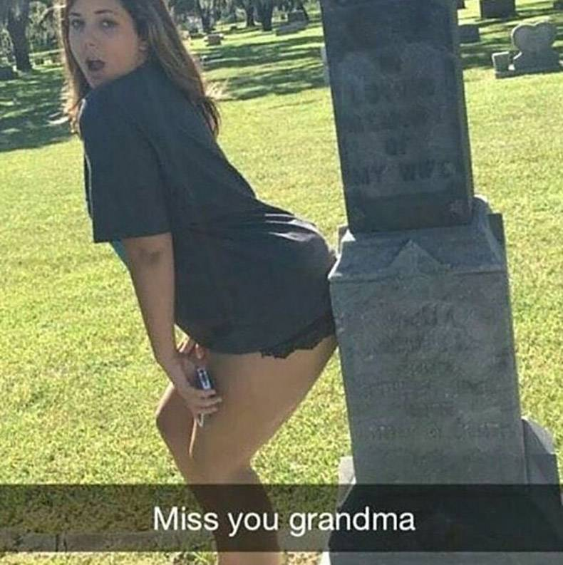 11 - Woman dancing provocatively against a grave stone in snapchat captioned 'Miss Your Grandma'