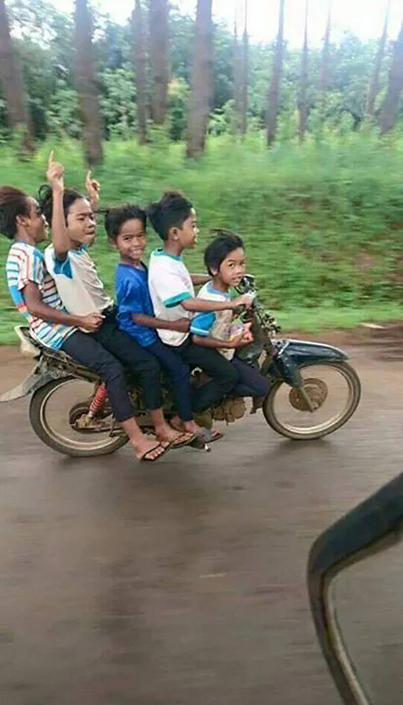 12 - 5 kids riding on a moped by themselves.
