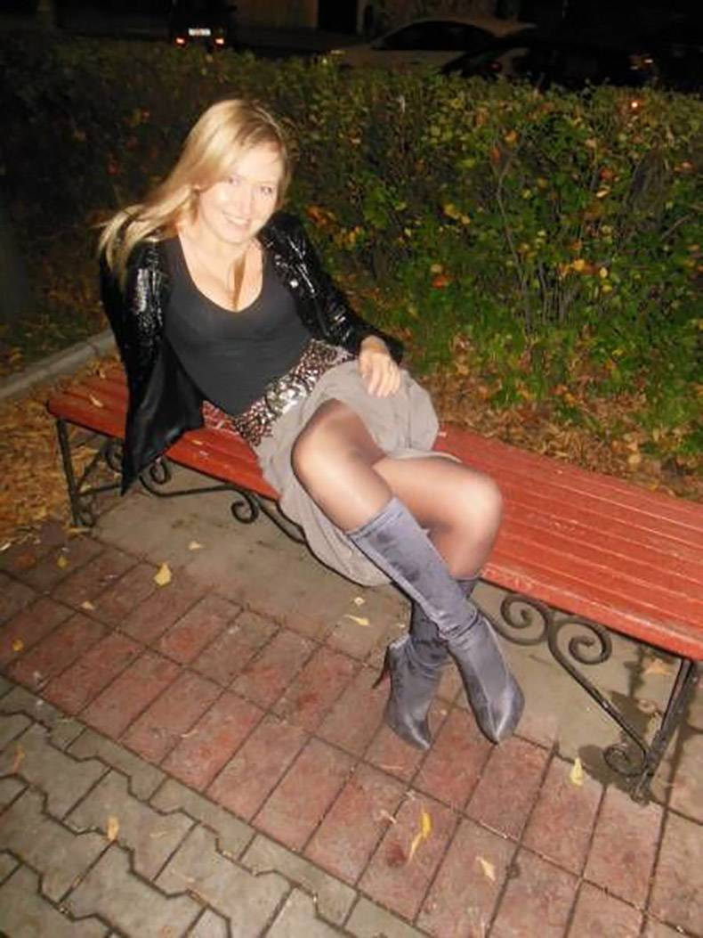 14 - Girl on a park bench and not sure what is happening with her legs.