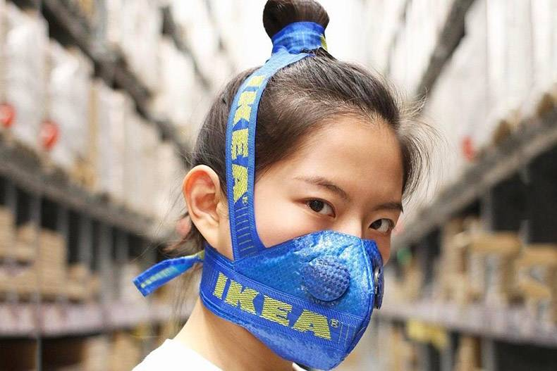 19 - Woman wearing a gas mask made out IKEA bag.