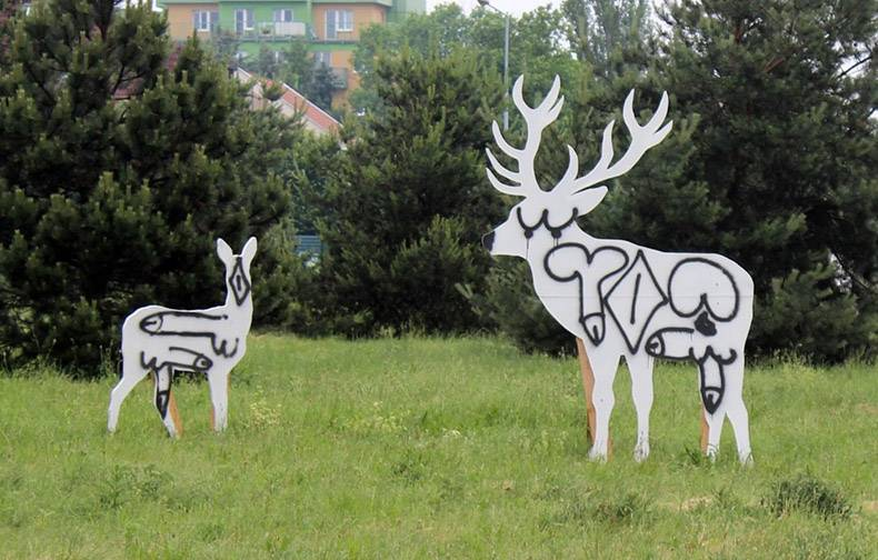 21 - Cutouts of moose and deer spray painted over with real immature symbols.