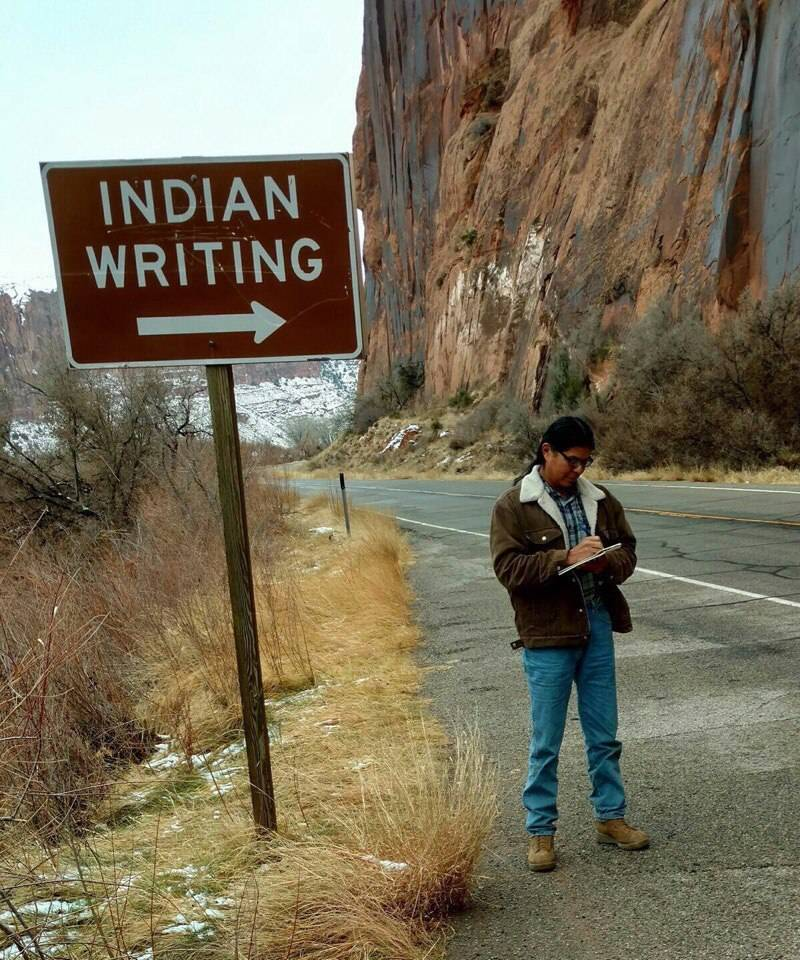 17 - Sign to the Indian writing with picture of Indian man writing