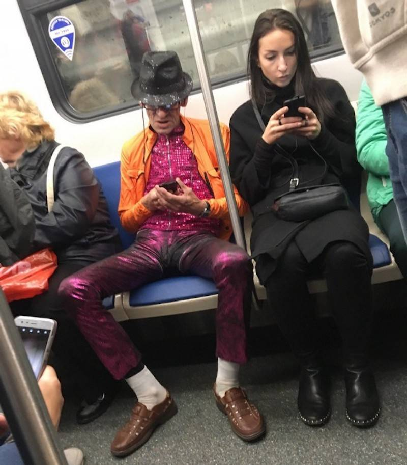 18 - man dressed in flashy outfit on the subway