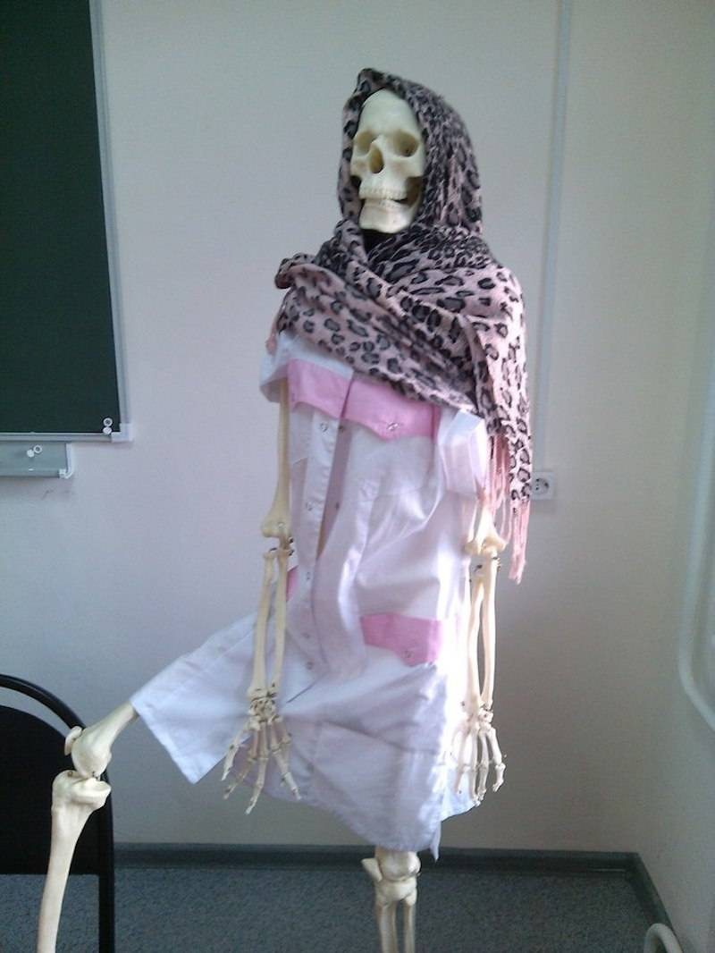 26 - Skeleton dress with traditional head covering.