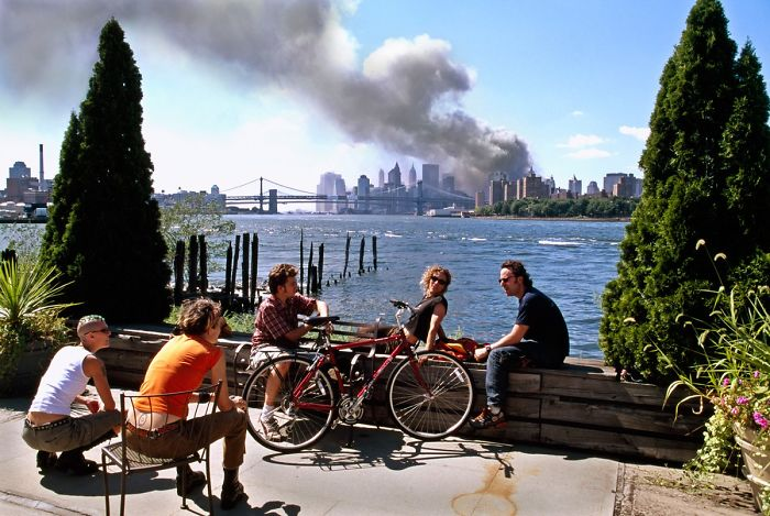 2 - 9/11 photo of young people lounging on the other side of the river as the towers collapsed.