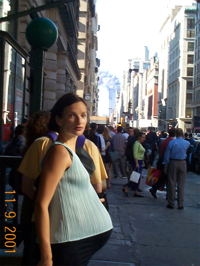 6 - Pregnant woman in photo with WTC burning in the background